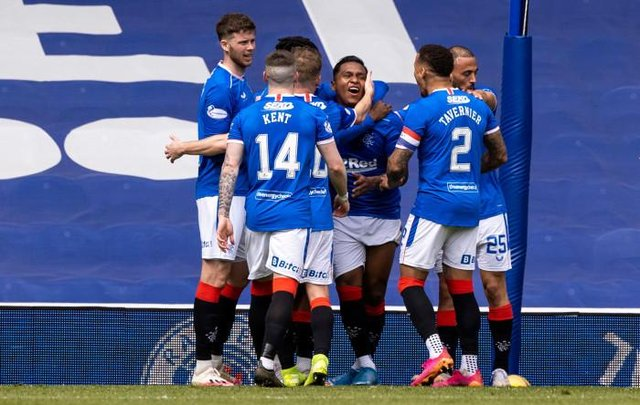 Rangers players celebrate with Alfredo Morelos after the striker had scored to put his team 2-1 up against Celtic at Ibrox. (Photo by Craig Williamson / SNS Group)