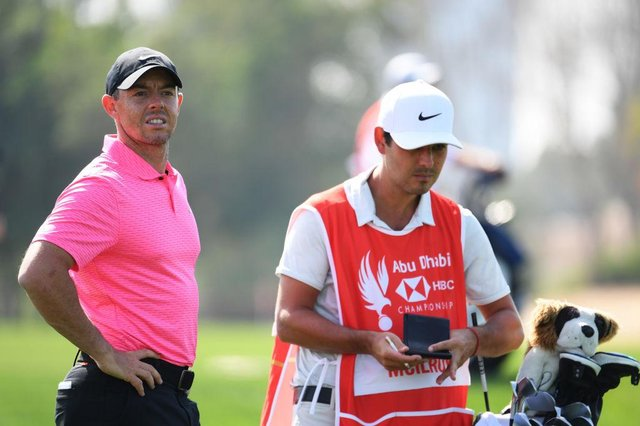 Rory McIlroy and caddie Harry Diamond look on during day one of the Abu Dhabi HSBC Championship at Abu Dhabi Golf Club. Picture: Ross Kinnaird/Getty Images.