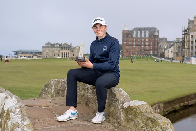 Broomieknowe's Hannah Darling shows off the St Rule Trophy after the last round on the Old Course. Picture: St Andrews Links Trust.