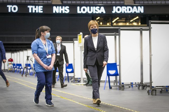First Minister of Scotland Nicola Sturgeon after receiving the first shot of the Astra Zeneca vaccine, administered by staff nurse Elaine Anderson, at the NHS Louisa Jordan vaccine centre in the SSE Hydro in Glasgow, Scotland. Picture date: Thursday April 15, 2021.