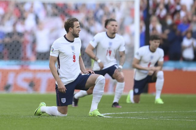 England's Harry Kane takes a knee in support of Black Lives Matter movement prior the Euro 2020 soccer semifinal match between England and Denmark