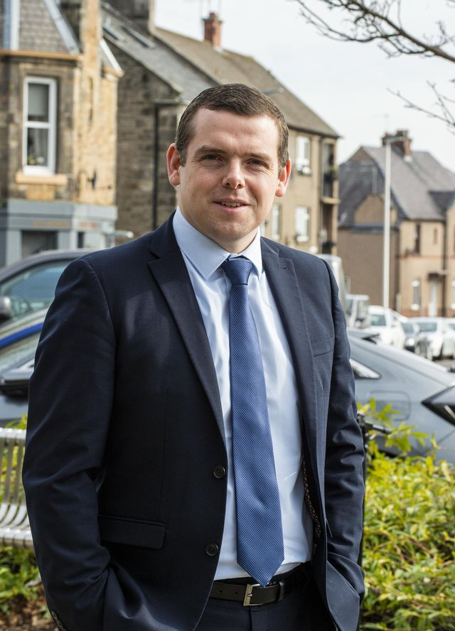 Douglas Ross has reshuffled his frontbench.      Scottish Conservative leader Douglas Ross visits the former Loanhead police station    He is unveiling his party's crime and justice manifesto pledges, which include the scrapping of Scotland's not proven verdict.    Other key policies are the creation of a Victims Law and a Local Policing Act.