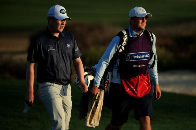 Bob MacIntyre and caddie Mikey Thompson walk on the 10th in the second round of the Omega Dubai Desert Classic at Emirates Golf Club. Picture: Andrew Redington/Getty Images.