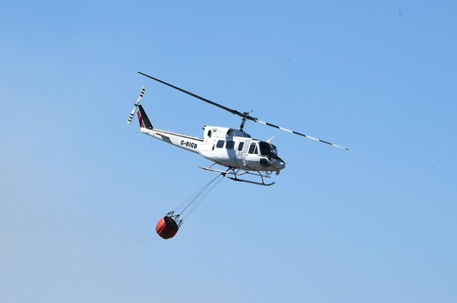 The Scottish Fire and Rescue Service has been using a helicopter to drop water in the Innerleithen blaze