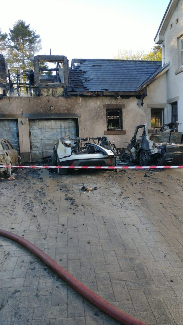The fire engulfed several cars and a reached the house in the early hours of Wednesday morning. (Picture credit: Evan Mclafferty)
