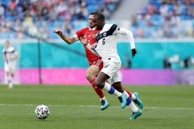 Rangers midfielder Glen Kamara battles for possession with Magomed Ozdoev during Finland's Euro 2020 Group B clash with Russia in St Petersburg on Wednesday afternoon. (Photo by Joosep Martinson - UEFA/UEFA via Getty Images)