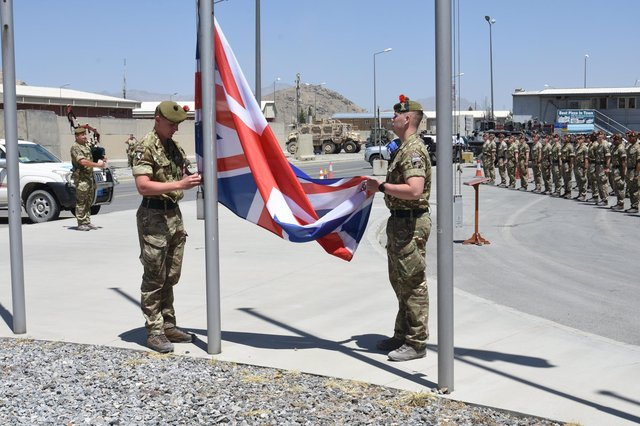 Soldiers from the Black Watch lower the Union flag in Afghanistan (Picture: Ministry of Defence)