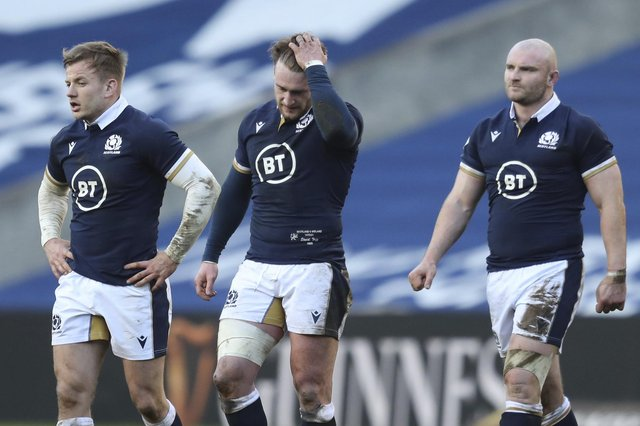 Scotland's Stuart Hogg, centre, reacts at the end of the Six Nations rugby union match between Scotland and Ireland at Murrayfield, Edinburgh, Scotland, Sunday, March 14, 2021. Ireland won the game 27-24. (Jane Barlow/Pool Via AP)