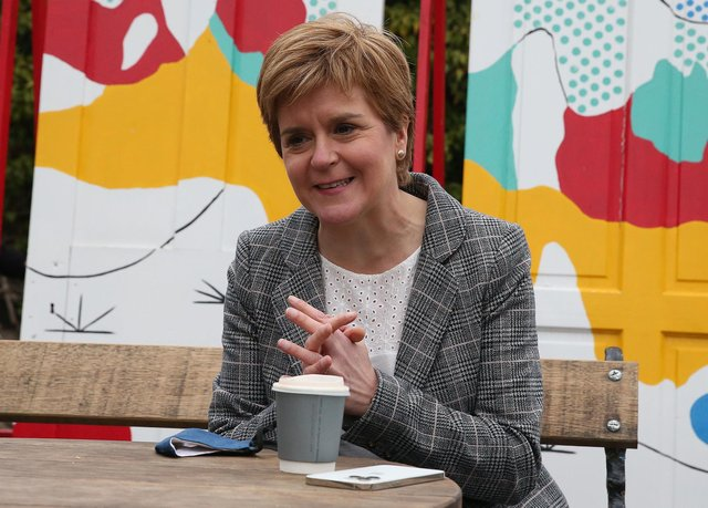 First Minister Nicola Sturgeon has a coffee during a visit to  North Berwick, on the campaign trail for the Scottish Parliamentary election.
