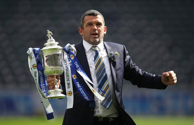 St Johnstone manager Callum Davidson holds the trophy after his team beat Hibs in the Scottish Cup Final at Hampden Park in May. Picture: Ian MacNicol/Getty Images.