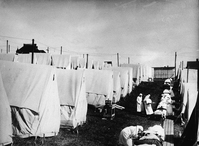 Nurses care for victims of a Spanish influenza epidemic in a field hospital of canvas tents. One soldier, in his account of the pandemic, wondered whether a war-weary God had sent a plague to finish off mankind, such was his horror of the new devastation that surrounded him.
