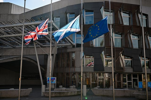 Flags fly at half mast outside the Scottish Parliament in Edinburgh to mark the death of the Duke Of Edinburgh. (Photo by Jeff J Mitchell/Getty Images)