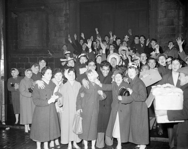 Hogmanay revellers at Tron Kirk Edinburgh 1959