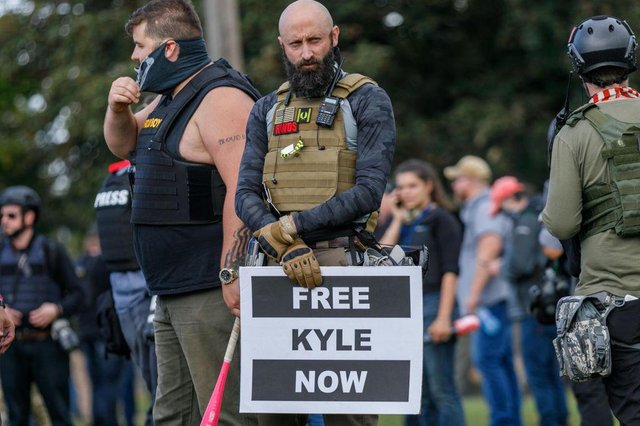 A Proud Boys member shows support for Kenosha shooter Kyle Rittenhouse at a gathering in Portland, Oregon (Getty Images)