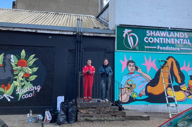 Nikki McGuigan, 30, and Molly Hankinson, 25, standing beside their colourful artwork on Frankfort Street in Shawlands (Photo: Hannah Brown).