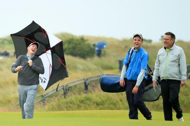 Bob MacIntyre has a laugh with Greg Milne, his caddie at the time, and coach David Burns during a practice round for the 148th Open Championshipat Royal Portrush in 2019. Picture: Andrew Redington/Getty Images.