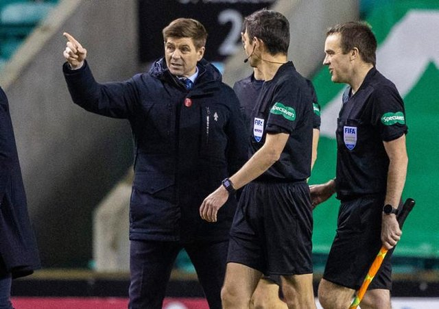 Rangers manager Steven Gerrard speaks to referee Kevin Clancy at full-time after his team's 1-0 win over Hibs at Easter Road. (Photo by Craig Williamson / SNS Group)
