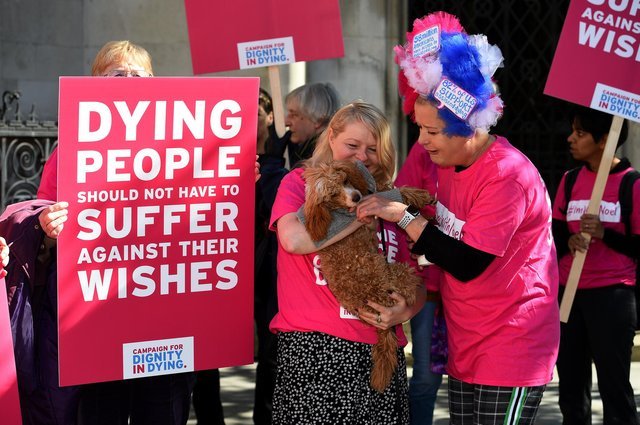 Activists from the Campaign for Dignity in Dying protest outside the Royal Courts of Justice in London (Picture: Kirsty O'Connor/PA)