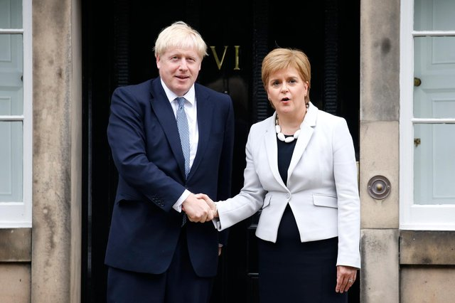 Nicola Sturgeon and Boris Johnson are political opponents, but they need to work together for the good of the country (Picture: Duncan McGlynn/Getty Images)