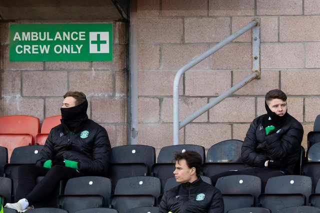 Hibs' Ryan Porteous (L) and Kevin Nisbet (R) were left on the bench against Dundee United after being linked with moves away from the club. Photo by Ross Parker / SNS Group