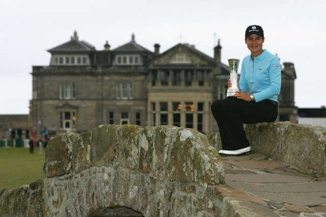 Lorena Ochoa of Mexico poses on the Swilcan Bridge with the trophy following her victory in the 2007 Ricoh Women's British Open held on the Old Course at St Andrews. Picture: Warren Little/Getty Images.