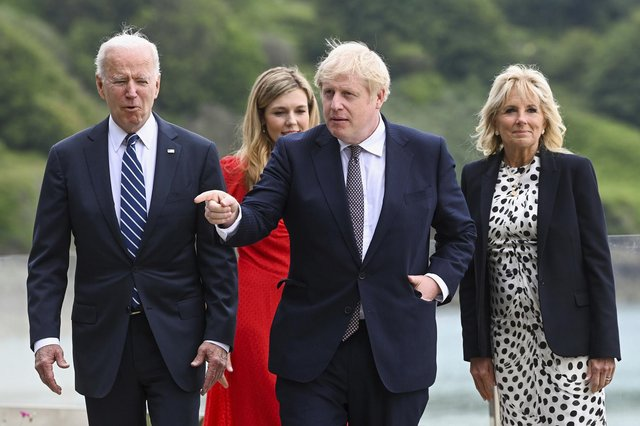 (From left) US President Joe Biden, Carrie Johnson, Britain's Prime Minister Boris Johnson and First Lady Jill Biden walk outside Carbis Bay Hotel in Cornwall. Picture: Toby Melville/Pool Photo via AP