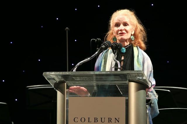 Carol Colburn Grigor speaks onstage in Los Angeles