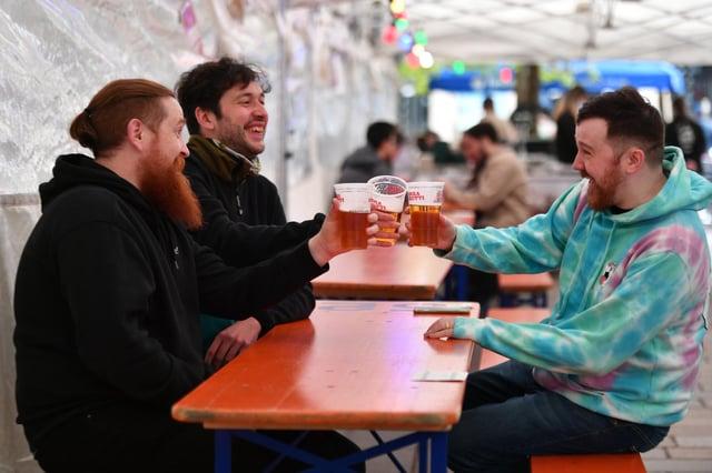 Glaswegians enjoy a pint under Covid-19 restrictions. Picture: John Devlin