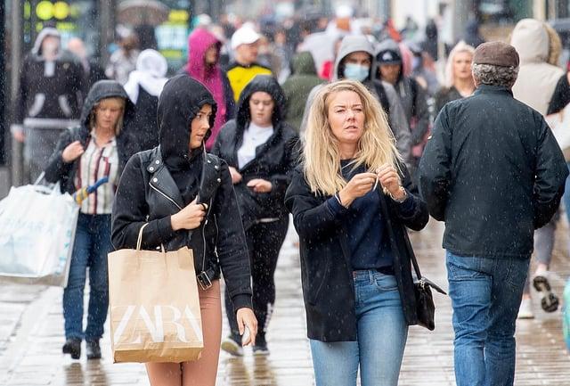 Pedestrians on Edinburgh's Princes Street. (Photo by LESLEY MARTIN/AFP via Getty Images)