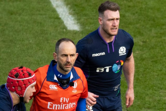 Stuart Hogg, right, alongside referee Romain Poite during the Scotland v Ireland match in 2019.