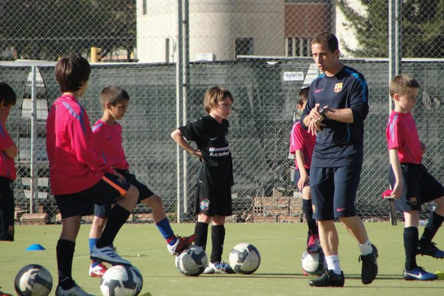 An eight-year-old Archie Meekison, centre in black, training with Barcelona in the shadow of Camp Nou.