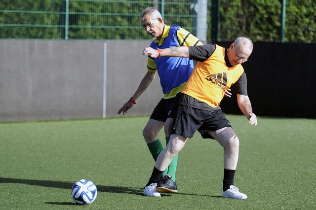"""The first ever """"Walking Football"""" tournament was held in Glasgow aimed at keeping people aged over-50 involved with football."""