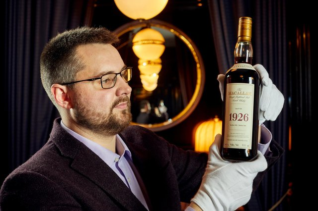 Whisky auctioneer founder Iain Mcclune with the 'Holy Grail' Macallan
