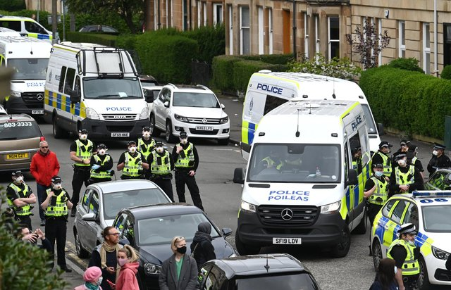 Police Scotland has bowed to mounting public pressure this afternoon, ordering the release of two men detained by immigration agents in Glasgow after a standoff with protesters.