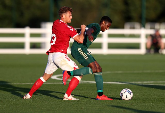 Celtic defender Osaze Urhoghide holds off a challenge from Bristol City striker Chris Martin during the pre-season friendly on Wednesday night. (Photo by Catherine Ivill/Getty Images)