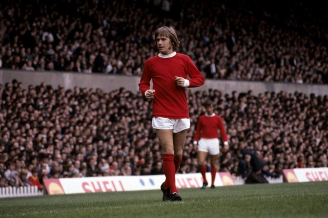 John Fitzpatrick in action for Manchester United.