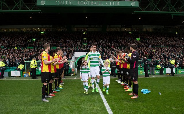 Celtic receiving a guard of honour from Partick Thistle after winning the title in 2017. Picture: SNS