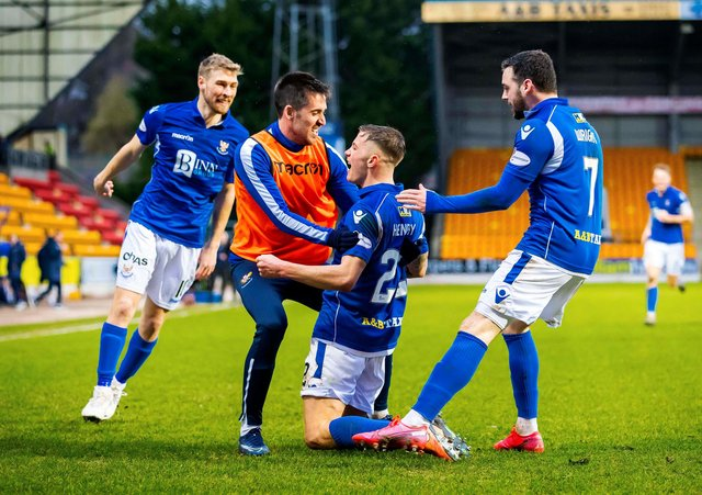 Callum Hendry celebrates with team mates after scoring the winner for St Johnstone