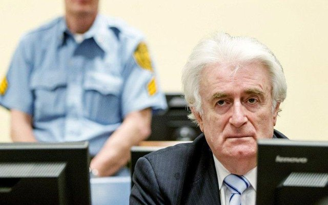 Bosnian Serb wartime leader Radovan Karadzic sits in the courtroom for the reading of his verdict in The Hague in 2016 picture: AFP/Getty Images