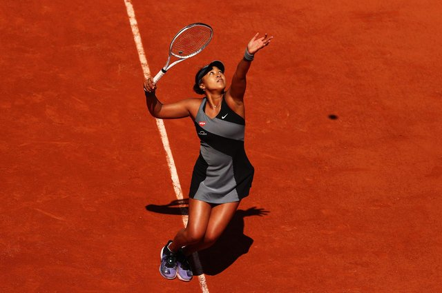 Naomi Osaka serves to Patricia Maria Tig of Romania during her first-round victory at the French Open at Roland Garros. Picture: Julian Finney/Getty Images