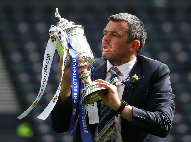 St Johnstone manager Callum Davidson celebrates with the Scottish Cup trophy after the final whistle during the Scottish Cup final match at Hampden Park, Glasgow.