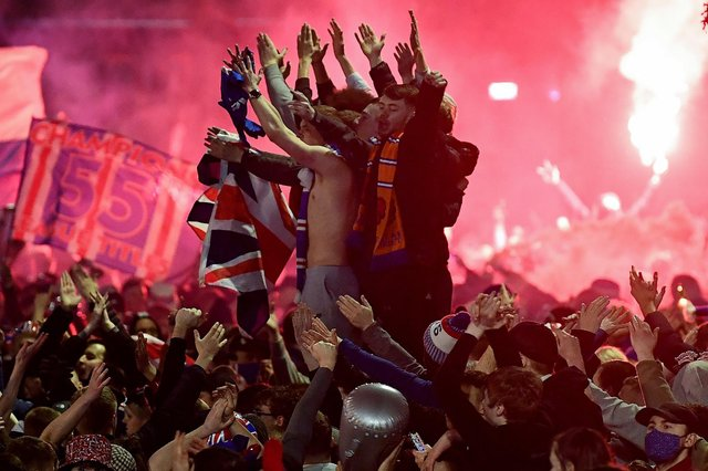 Rangers fans gather in Glasgow's George Square to celebrate the club winning the Scottish Premiership for the first time in ten years on March 7. Picture: Jeff J Mitchell/Getty Images