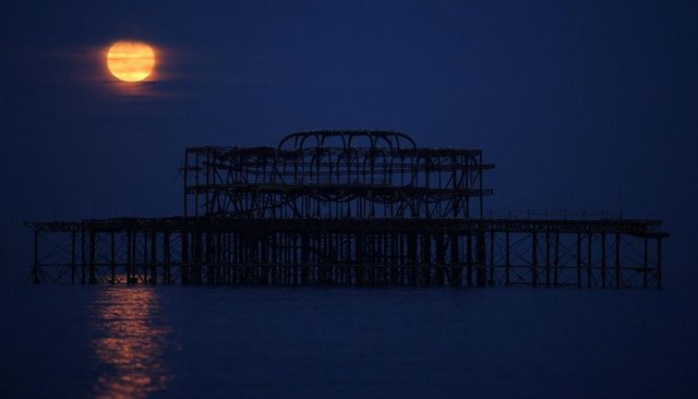 A supermoon rising over the West Pier on May 07, 2020 in Brighton.