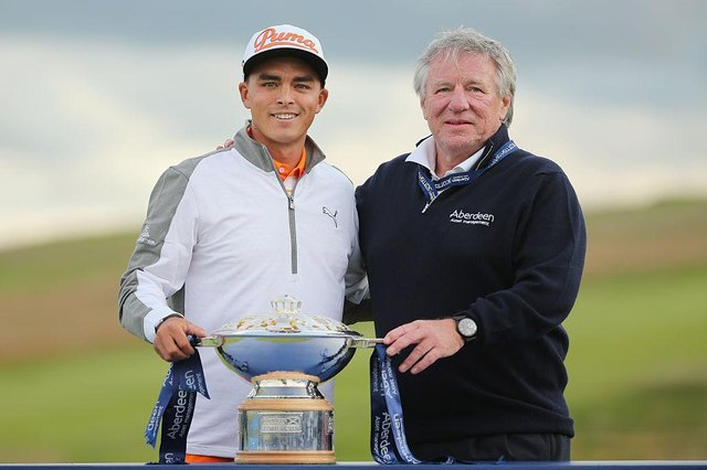 Martin Gilbert, pictured with Rickie Fowler after the American's win in the 2015 Aberdeen Standard Investments Scottish Open at Gullane, is set to take over as Scottish Golf's new chair this weekend. Picture: Mike Ehrmann/Getty Images.