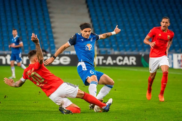 Benfica's Nicolas Otamendi in the thick of the action against Poznan last week (Photo by Wojtek RADWANSKI / AFP) (Photo by WOJTEK RADWANSKI/AFP via Getty Images)
