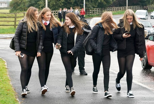 Pupils arrive at Kelso High School on the Scottish Borders as schools in Scotland start reopening on Tuesday amid concerns about the safety of returning to the classroom during the coronavirus pandemic. PA Photo. Picture date: Tuesday August 11, 2020. See PA story EDUCATON Schools. Photo credit should read: Owen Humphreys/PA Wire