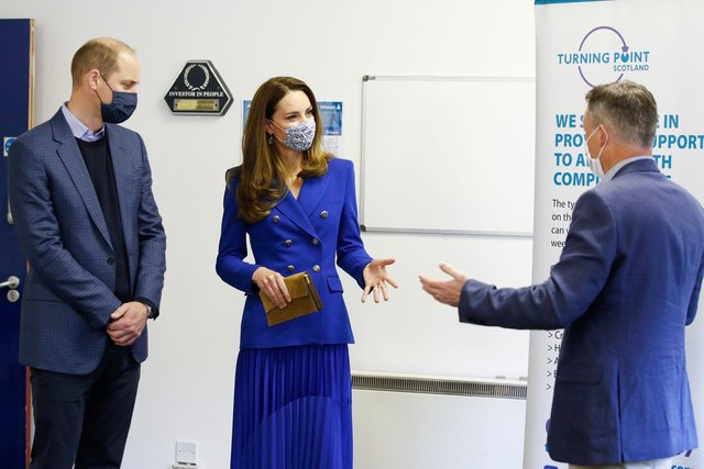 The Duke and Duchess of Cambridge with Neil Richardson (right), CEO of Turning Point Scotland, during a visit to their social care centre in Coatbridge, North Lanarkshire.(Credit: Phil Noble/PA Wire)