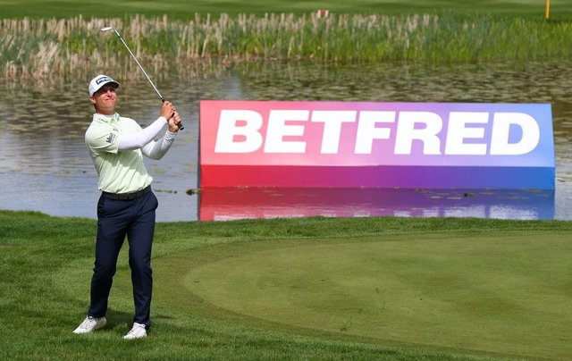 Calum Hill chips on to the 18th green during the first round of The Betfred British Masters hosted by Danny Willett at The Belfry. Picture: Richard Heathcote/Getty Images.