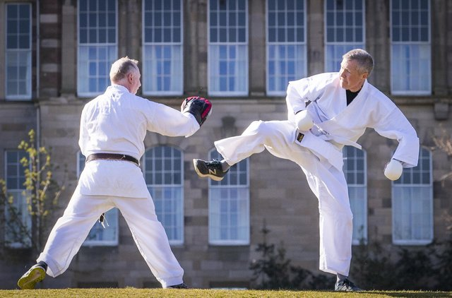 The Lib Dem leader taking part in a karate lesson with Robert Steggles at the Meadows.  Pic: Jane Barlow