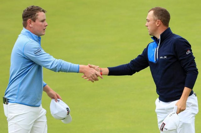Bob MacIntyre and Justin Thomas shake hands after playing together in the third round of the 148th Open Championship at Royal Portrush in 2019. Picture: Andrew Redington/Getty Images.